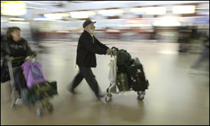 Travellers moving through Heathrow airport