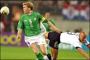 Republic of Ireland's Steve Staunton in action against Germany's Carsten Jancker