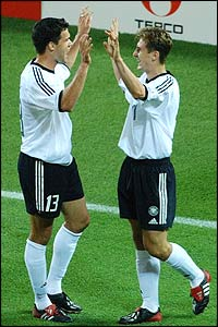 Germany's Miroslav Klose, s congratulated by team-mate Michael Ballack