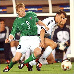 Republic of Ireland's Damien Duff challenges Miroslav Klose of Germany for the ball