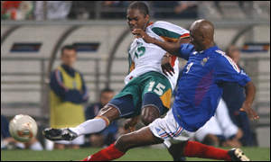 Salif Diao tackles Patrick Viera in the World Cup opening game