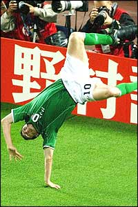 Ireland's Robbie Keane celebrates with a cartwheel after scoring against Germany
