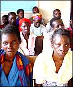 Aids victims waiting for food at the village of Henga