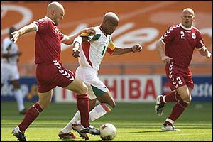 Denmark's Thomas Gravesen and Stig Tofting keep a close eye on Senegal forward El Hadji Diouf