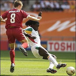 Denmark winger Jesper Gronkjaer is tackled by Senegal defender Ferdinand Coly