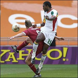Jon Dahl Tomasson falls under the challenge of Senegal's Salif Diao