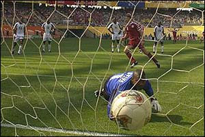 Jon Dahl Tomasson scores from the spot against Senegal