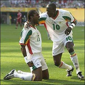 Salif Diao celebrates his equalising goal with Khalilou Fadiga