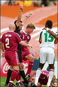 Senegal's Salif Diao (left) is sent off after 79 minutes for a dangerous tackle on the grounded Rene Henriksen