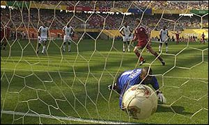 John Dahl Tomasson scores Denmark's opener from the penalty spot