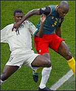 Saudi's Obeid Al Dossary (left) tussles with Cameroon's Pierre Wome