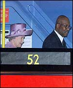 The Queen on a bus with Eugene Collymore