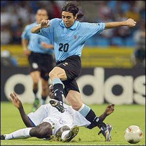 Uruguay forward Alvaro Recoba skips the challenge of France defender Lilian Thuram