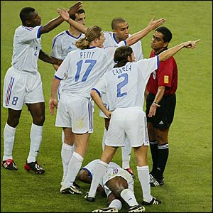 French players surround the referee after a foul on Patrick Vieira