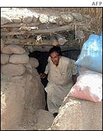 Kashmiri on the Pakistani side of the Line of Control emerges from his bomb shelter near the front line