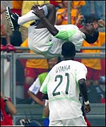 Nigeria's John Utaka watches goalscorer Julius Aghahowa celebrate in style