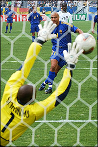 Henrik Larsson sends his penalty past Nigeria keeper Ike Shorunmu