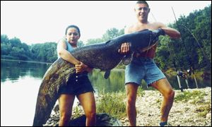 Mrs and Mrs Broadbent with catfish