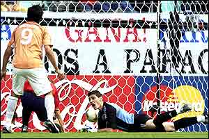 Spanish goalkeeper Iker Casillas can't stop the ball going into the back of the net off Puyol
