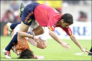 Spain's Raul gets tangled up with Carlos Paredes of Paraguay