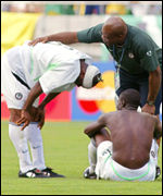 Assistant coach Fanny Amun (middle) consoles Taribo West after the loss to Sweden