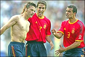 Spain's Fernando Morientes (left) celebrates scoring with Raul and Juanfran
