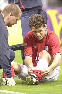 An England physiotherapist tends to the injured Owen Hargreaves