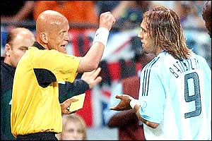 World famous referee Pierluigi Collina shows Batistuta a yellow card
