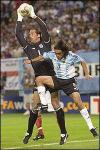 David Seaman makes a save as he is put under pressure from the Argentina attack