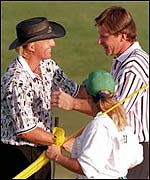 Nick Faldo (right) commiserates Greg Norman at Augusta in 1996