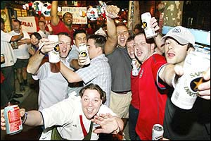 Jubilant England football fans gather to celebrate their side's 1-0 win over arch-rivals Argentina in their Group F clash