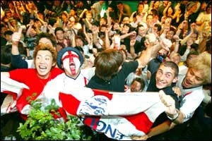 England fans celebrate the team's victory over Argentina in Tokyo's Roppongi Entertainment Centre