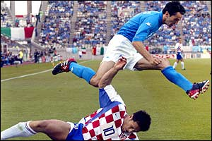 Italian defender Christian Panucci jumps over Croatian midfielder Niko Kovac