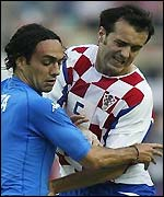 Alessandro Nesta of Italy grapples with Milan Rapaic of Croatia