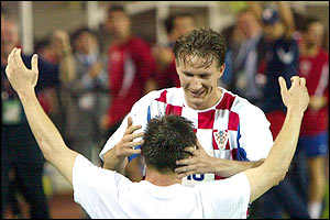 Croatia's Milan Rapaic is congratulated by team-mate Niko Kovac