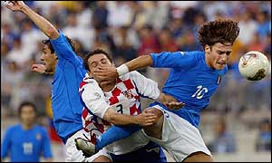 Francesco Totti (right) fights for an aeriall ball with Croatia's Josip Simunic