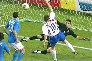Croatia's Ivica Olic scores as Italy's goallkeeper Gianluigi Buffon is floored