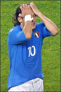 Italian forward Francesco Totti looks dejected after a missed shot