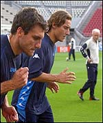 Christian Vieri and Francesco Totti train under the gaze of Giovanni Trapattoni