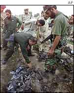 Pakistani soldiers examine the wreckage of the Indian spy plane