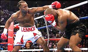 Lennox Lewis swings at Mike Tyson