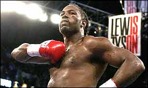 Lennox Lewis celebrates his victory over Mike Tyson