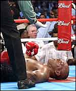 Mike Tyson is counted out by referee Eddie Cotton