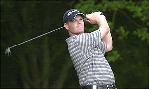 Drysdale of Scotland misses the fairway on his way to a double-bogey six at the first