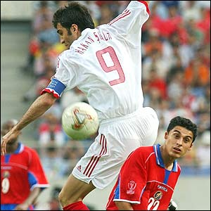 Turkey's Hakan Sukur vies for the ball with Carlos Castro of Costa Rica
