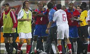 Tempers boiled over after Emre Belozoglu pushed a member of the Costa Rican coaching staff