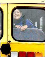 Child in school bus window