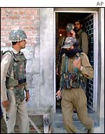 Policemen during a raid on Mr Geelani's house