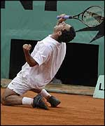 Costa falls to his knees after the winning point