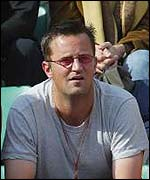 Actor Matthew Perry watches the men's semi-finals at the French Open
